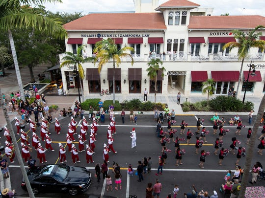 The Immokalee High School marching band plays down Fifth Avenue South during the 20th Annual Rev. Dr. Martin Luther King Jr. Parade and Celebration in downtown Naples on Monday, Jan. 16, 2017.