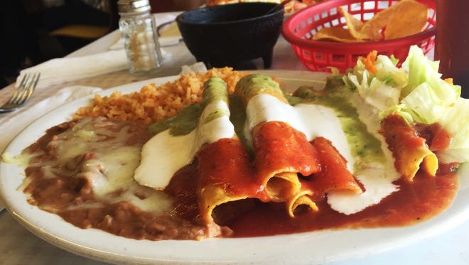Beef flauta plate, salsa, sour cream, and guacamole sauce, with rice and beans ($4.59) from Giro's off Picacho Avenue.