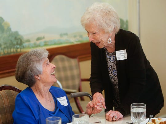 Virginia Savage, right, and Hazel Riker, talk while
