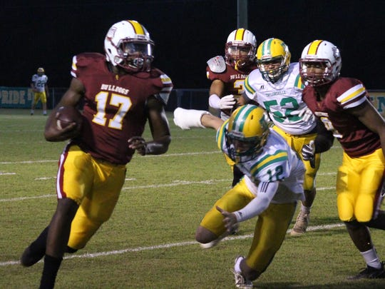 Perry Central quarterback Tijuane Bolton runs away from the Taylorsville defense Friday in New Augusta.