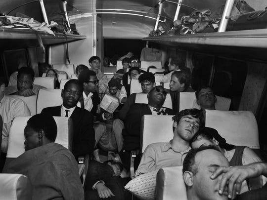 City College of New York (CCNY) students sleeping ovenight on bus to meet up with the Selma to Montgomery civil rights march on March 24, 1965.