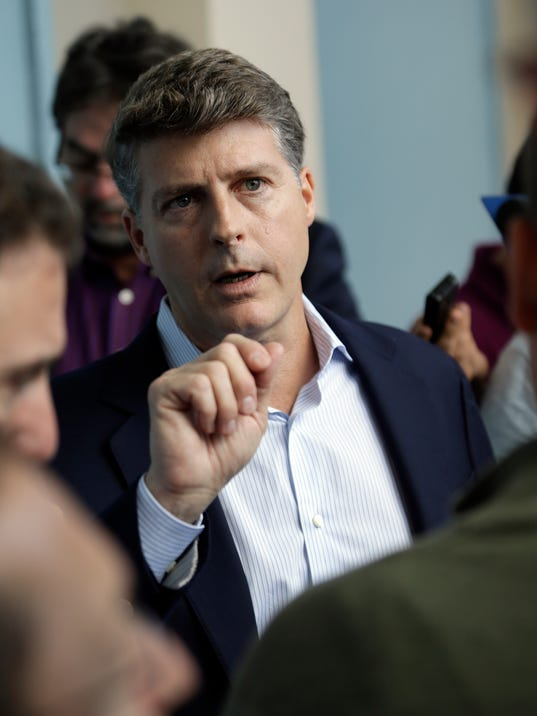 Hal Steinbrenner, principal owner, managing general partner and co-chairman of the New York Yankees, talks with reporters at the annual MLB baseball general managers' meetings, Wednesday, Nov. 15, 2017, in Orlando, Fla. (AP Photo/John Raoux)