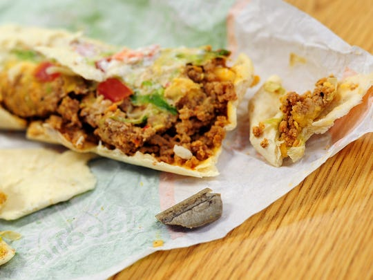 Jim Wagner said he found this piece of gray plastic in a soft beef taco he ordered at the Lancaster Drive NE Taco Time on Tuesday.
