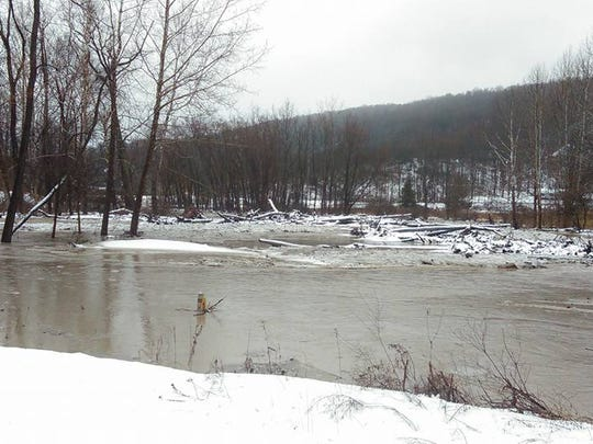 A swollen creek in the Shelter Valley area of Newfield following a storm on Tuesday, Feb. 16.