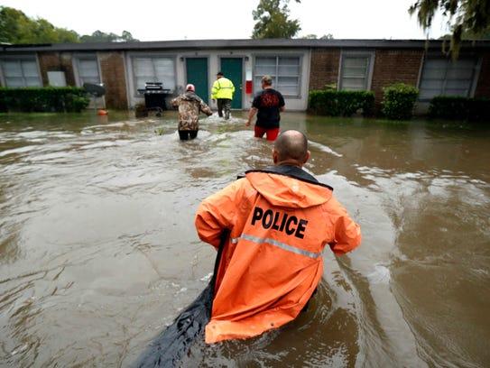 Volunteers assist police in making welfare checks on