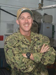 Petty Officer 3rd Class Mark Devries, of Tulare, is