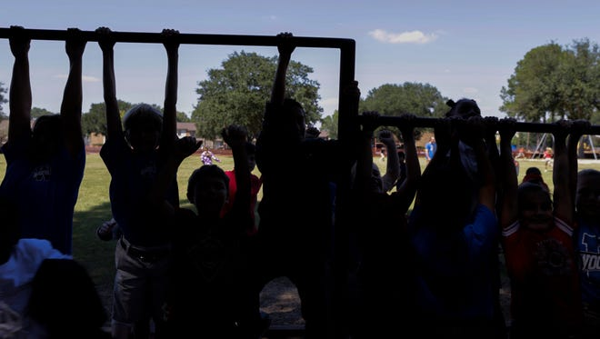 Fourth graders play during recess at Woodvale Elementary School  in Lafayette Sept. 30, 2016 .