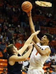 UTEP's Paul Thomas reaches high for a shot over Byron Frohnen of UT San Antonio during a Feb. 10 game at the Don Haskins Center.