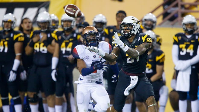 Jaelen Strong hauls in a Taylor Kelly pass against the Arizona Wildcats and scores a touchdown on Nov.30, 2013 in Tempe.