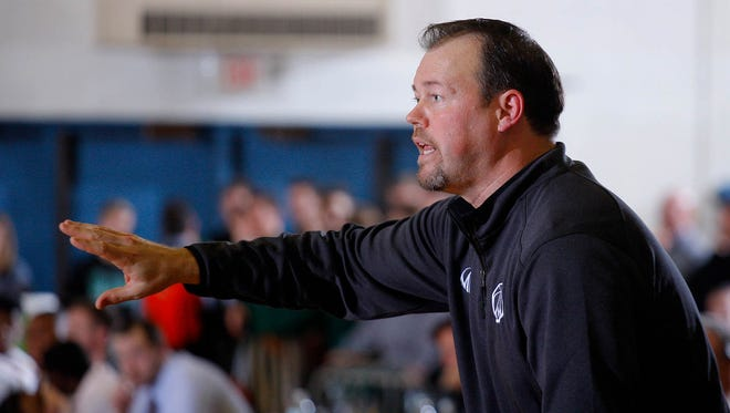Williamston coach Tom Lewis gives instructions during an MHSAA regional game against Godwin Heights Monday, March 13, 2017, in Ionia, Mich. Williamston won 69-65.