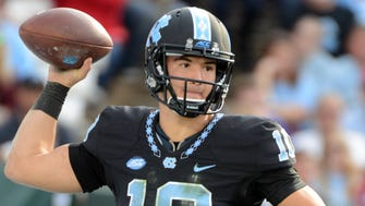 Nov 25, 2016; Chapel Hill, NC, USA;  North Carolina Tar Heels quarterback Mitch Trubisky (10) throws a pass during the second half against the North Carolina State Wolfpack at Kenan Memorial Stadium. The Wolfpack won 28-21. Mandatory Credit: Rob Kinnan-USA TODAY Sports