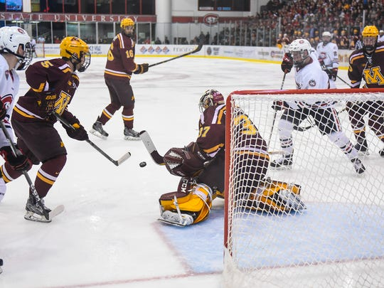 St. Cloud State players converge on the University