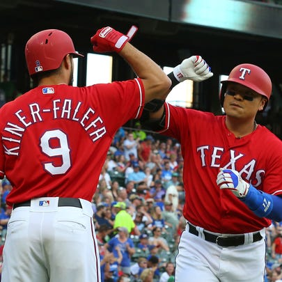 Texas Rangers Isiah Kiner-Falefa (9) bumps elbows with