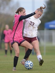 Collierville freshman Abby Johnson makes contact with