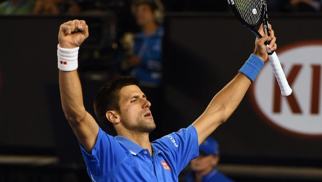 Serbia's Novak Djokovic celebrates after victory against Switzerland's Stanislas Wawrinka during their men's singles semifinal match.He will play Andy Murray in the finals.
