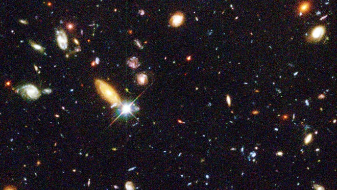 """Several hundred never before seen galaxies are visible in this """"deepest-ever"""" view of the universe, called the Hubble Deep Field (HDF), made with NASA's Hubble Space Telescope."""