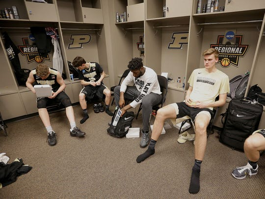 The Purdue Boilermakers in the locker room following