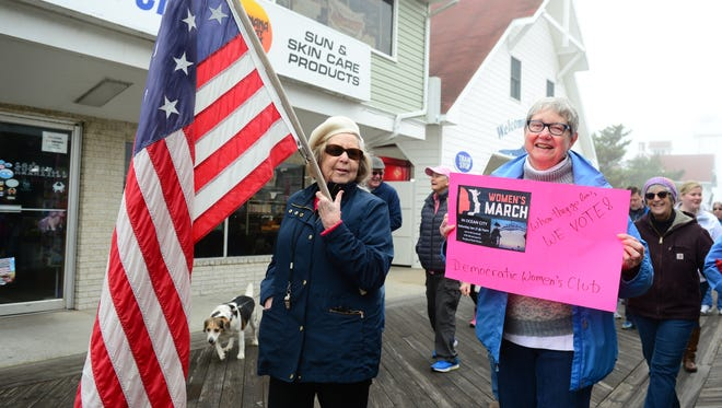 Members of The Democratic Women's Club of Worcester County's Women's lead the March Sister March on the boardwalk in Ocean City, Md. on Saturday, Jan 21, 2017.
