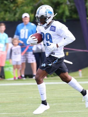 Asheville High alum Crezdon Butler made a one-handed interception Tuesday during Detroit Lions training camp.