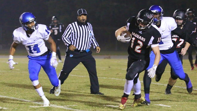 West Florida High running back Bryant Johnecheck runs with the ball against Trinity Christian on Friday night at Woodham Middle School.
