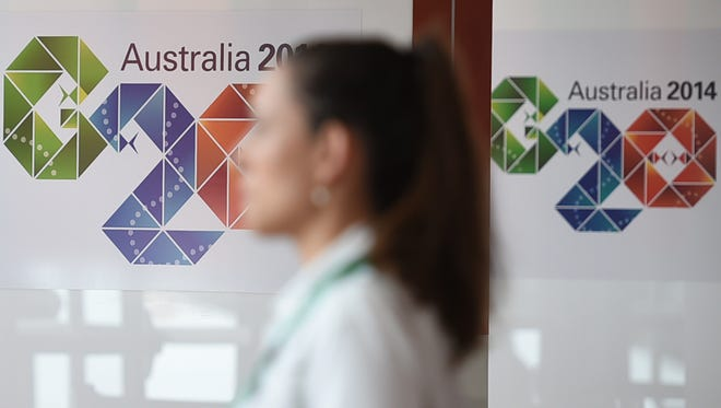A visitor walks through the news media center before the G-20 Summit in Brisbane.