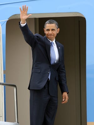 May 16, 2011 -  President Barack Obama waves from the doorway of Air Force One as he leaves  Memphis after speaking at the Booker T. Washington High School graduation ceremonies.  (Dave Darnell / The Commercial Appeal)