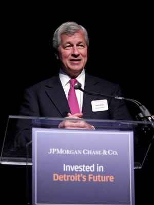 JPMorgan Chase CEO Jamie Dimon seen in May 2014 file photo addressing community and elected leaders in Detroit.