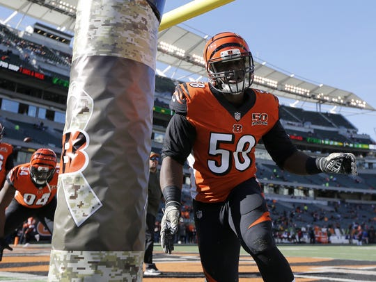 Cincinnati Bengals defensive end Carl Lawson (58) practices