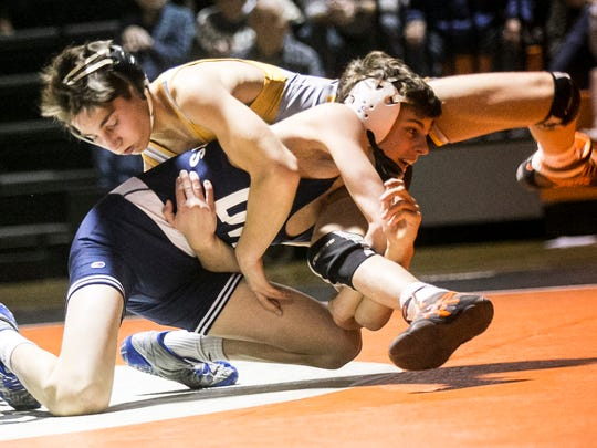 Dallastown's Cael Turnbell tries to flip Central York's