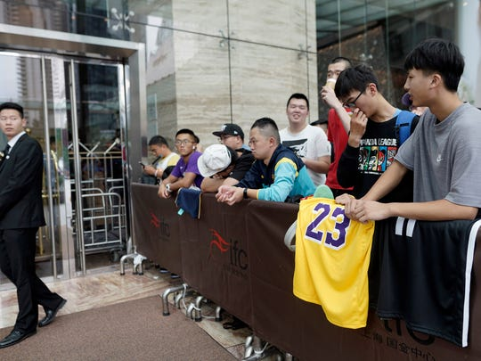 Fans gather outside a hotel for a news conference that was later postponed ahead of a preseason game between the Los Angeles Lakers and Brooklyn Nets in Shanghai.