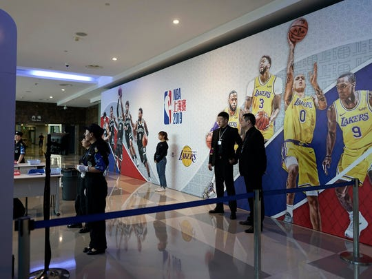 Security personnel wait for spectators to arrive at a checkpoint to an NBA preseason game to be held at the Mercedes Benz Arena in Shanghai, China, Thursday, Oct. 10, 2019. All media events such as news conferences have been canceled inside the arena hosting Thursday's NBA preseason game in China between the Los Angeles Lakers and Brooklyn Nets, though the matchup itself remains on as scheduled. (AP Photo)