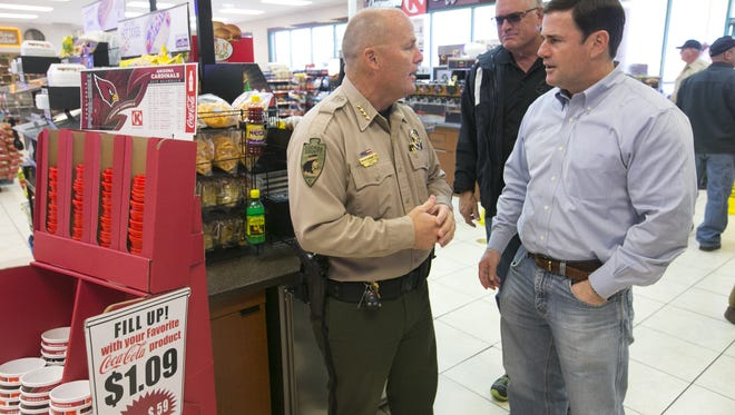 Cochise County Sheriff Mark Dannels speaks with Arizona Governor Doug Ducey at a Circle K convenience store in Sierra Vista on Nov. 6, 2015. Homeland Security Secretary Kirstjen Nielsen nominated Cochise County Sheriff Mark Dannels to join her Homeland Security Advisory Council.