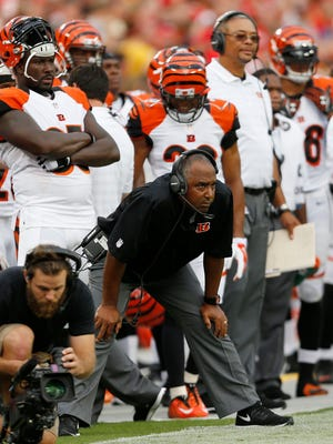 Cincinnati Bengals head coach Marvin Lewis keeps an eye on his team in the first quarter against the Kansas City Chiefs at Arrowhead Stadium. The Enquirer/Jeff Swinger