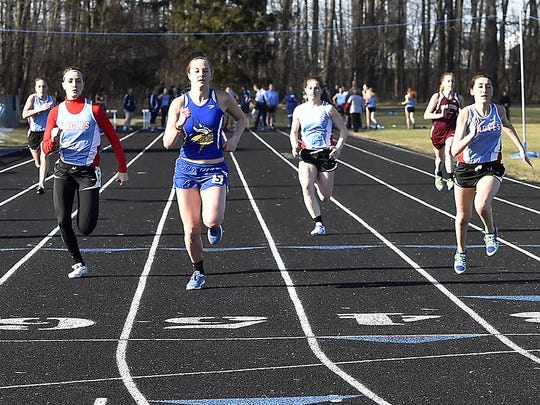 Gibraltar's Bria Caldecott, center, is flanked by Southern Door runners Alyssa Delfosse and Katie Guilette as she wins the girls 100-meter dash at a Packerland Conference quadrangular meet Tuesday at Southern Door.