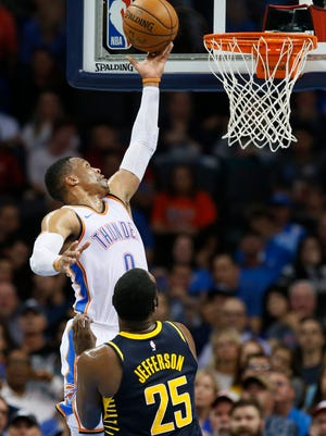 Oklahoma City Thunder guard Russell Westbrook (0) shoots in front of Indiana Pacers center Al Jefferson (25) in the second quarter of an NBA basketball game in Oklahoma City, Wednesday, Oct. 25, 2017.
