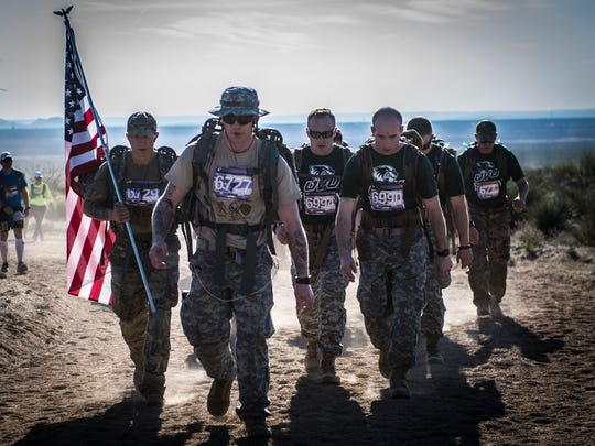 A team of participants in 2016 Bataan Memorial Death March make their way through the course at White Sands Missile Range March 20. Over 6,000 participants came to honor more than 76,000 Prisoners of War and Missing in Action from Bataan and Corregidor during World War II. The 26.2-mile course starts on WSMR, enters hilly terrain and finishes through sandy desert trails, with elevation ranging from 4,100 to 5,300 feet.