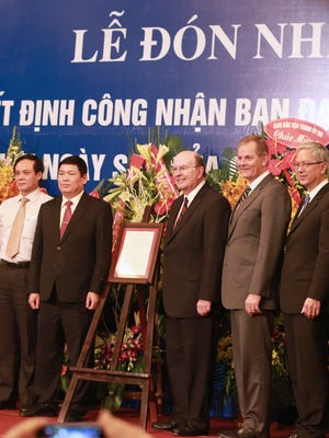 From left are Honorable Le Ba Trinh, vice president of the Fatherland Front; Bui Thanh Ha, vice chairman for Religious Affairs; Elder Quentin L. Cook and Elder Gary E. Stevenson of the Quorum of the Twelve Apostles; and Elder Gerrit W. Gong of the Presidency of the Seventy.