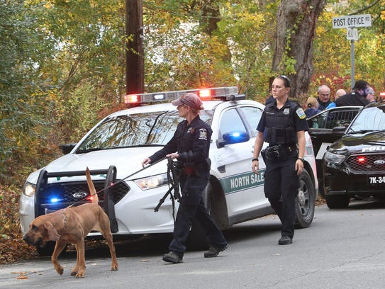 A New York Police Bloodhound searches at the intersection