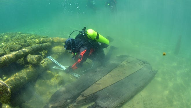 A diver explores the remains of the Jacksonport Wharf. A boundary increase to the archaeological historic district has been added to the National Register of Historic Places.