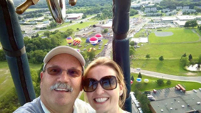 Ted Gauthier and daughter Dawn McKenzie are part of a seven-member family of pilots flying together for the first time ever at this weekend's Michigan Challenge Balloonfest in Howell.