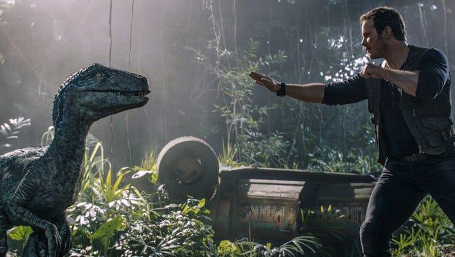 """Chis Pratt faces down the dinosaur at """"Jurassic Park: Fallen Kingdom."""" opening Friday."""