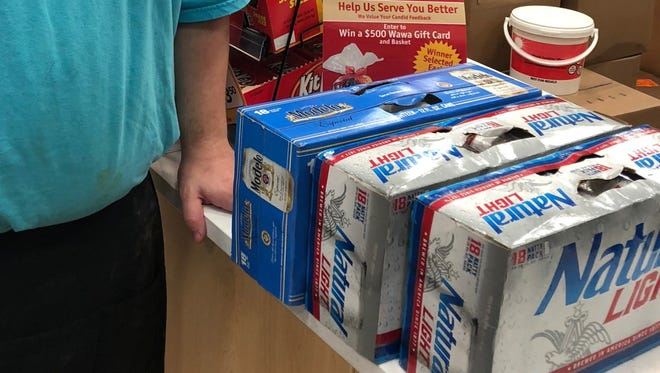 Three cases of beer taken from a Port Charlotte Wawa were returned after a brief police chase and the arrest of two alleged thieves on Sunday.