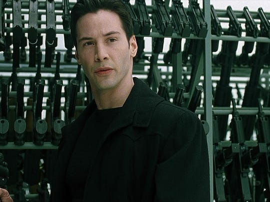 """Keanu Reeves arms himself as Neo in """"The Matrix."""""""