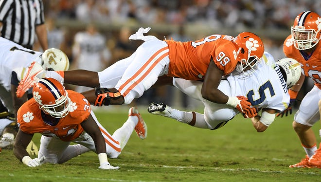 Clemson defensive end Clelin Ferrell (99) brings down Georgia Tech quarterback Justin Thomas (5) during the 1st quarter at Georgia Tech's Bobby Dodd Stadium in Atlanta on Thursday, September 22, 2016.