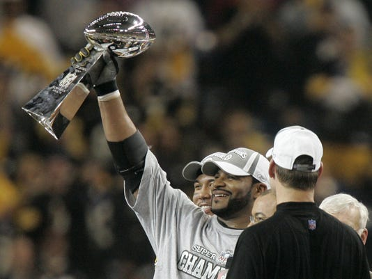 FILE - In this Feb. 5, 2006, file photo, Pittsburgh Steelers' Jerome Bettis hoists the Vince Lombardi Trophy as coach Bill Cowher, right, and MVP Hines Ward, left, watch as they celebrate the Steelers' 21-10 win over the Seattle Seahawks in the Super Bowl XL NFL football game in Detroit. (AP Photo/Charlie Neibergall, File