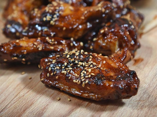 Char-broiled chicken wings with bourbon barbecue sauce are being served from one of the food booths at the Eldorado's annual Brew Fest, June 16-17.