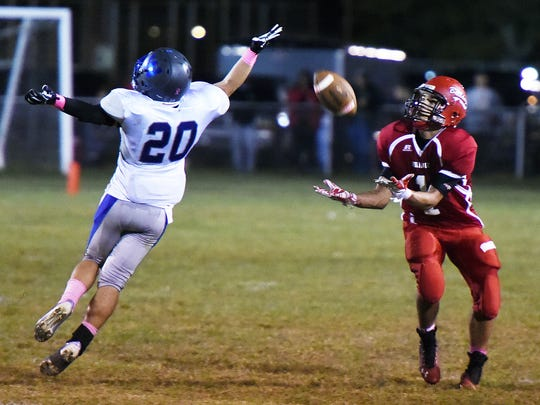 Laurels #1 Reginald Green catch's a 51 yard pass as WB #20 Garret Temple defends as Laurel High School (red) hosted Woodbridge HS (white) in Varsity Football at the school in Laurel on Friday October 3rd.