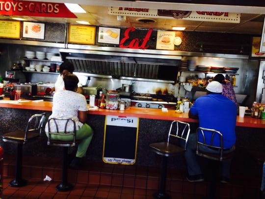 Diners sit at the counter at Cotton Boll Grill on