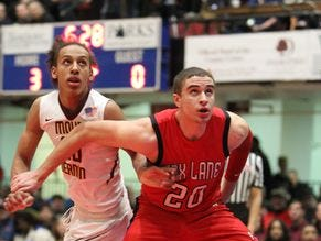 Matt Redhead, The Journal News and lohud.com's Westchester/Putnam player of the year, battles Mount Vernon's Noah Morgan for a rebound. Fox Lane beat Mount Vernon 67-60 in the Class AA final at the Westchester County Center Feb. 28, 2016.