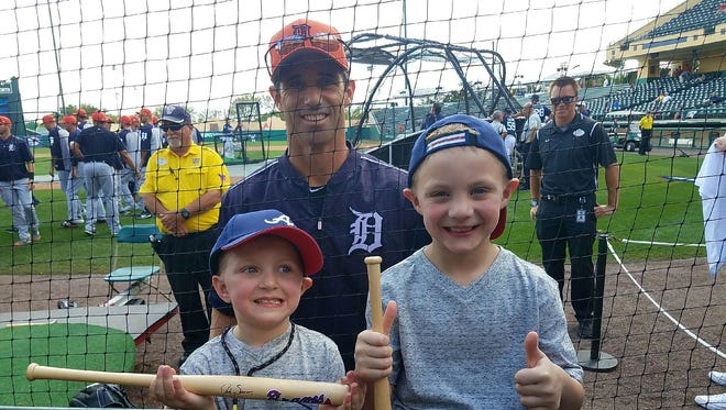 Tigers manager Brad Ausmus, center, poses with Adam Ausmus, 4, left, and Ashton Ausmus, 7, of Blissfield before Monday's exhibition against the Braves.